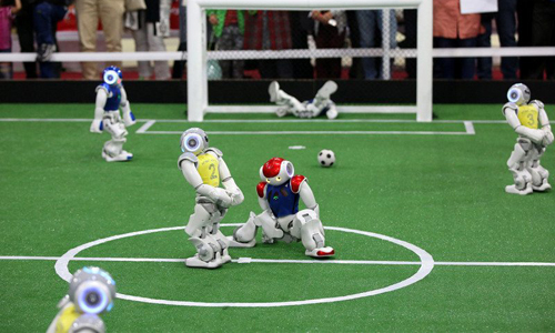 Robot football players on field